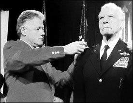 President Bill Clinton pinning the four-star insignia on General Benjamin O. Davis, Jr. - Great Black Heroes